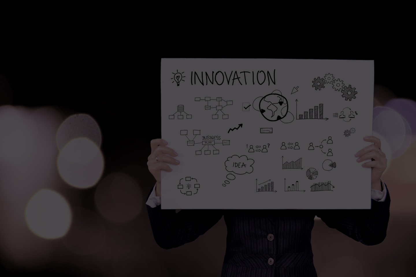 the picture shows a person holding a big canvas for innovation